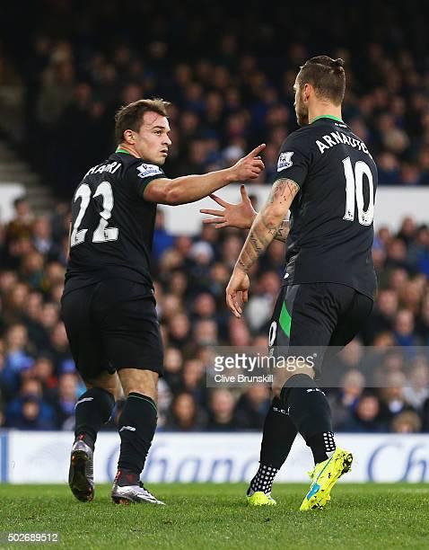 Xherdan Shaqiri of Stoke City celebrates scoring his team's first goal with his team mate Marko Arnautovic during the Barclays Premier League match...