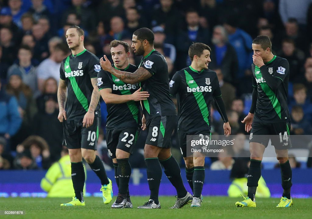 Xherdan Shaqiri of Stoke City celebrates scoring his team's second goal with his team mates during the Barclays Premier League match between Everton and Stoke City at Goodison Park on December 28, 2015 in Liverpool, England.