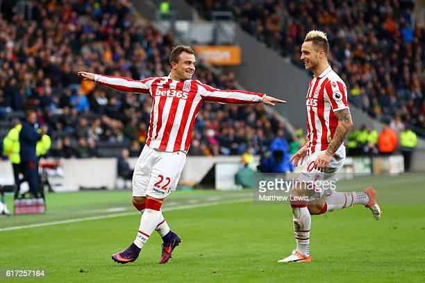Xherdan Shaqiri of Stoke City celebrates scoring his team's second goal with his team mate Marko Arnautovic during the Premier League match between...