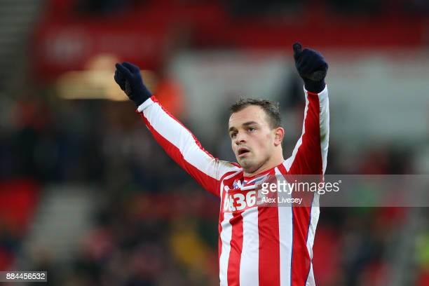 Xherdan Shaqiri of Stoke City celebrates victory after the Premier League match between Stoke City and Swansea City at Bet365 Stadium on December 2...