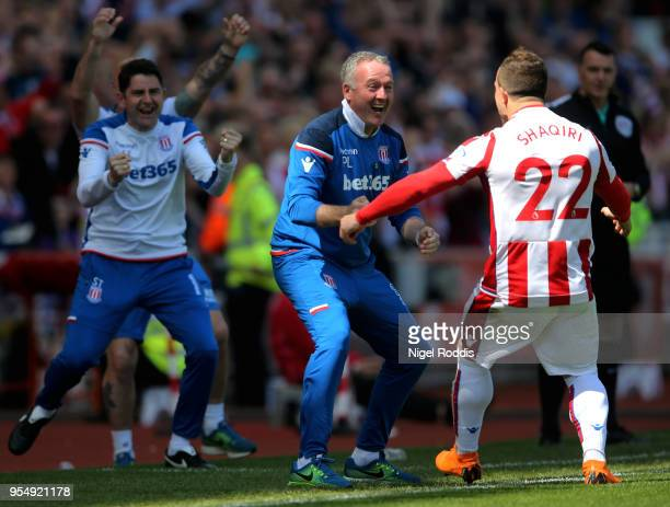 Xherdan Shaqiri of Stoke City celebrates with Paul Lambert Manager of Stoke City after scoring his sides first goal during the Premier League match...