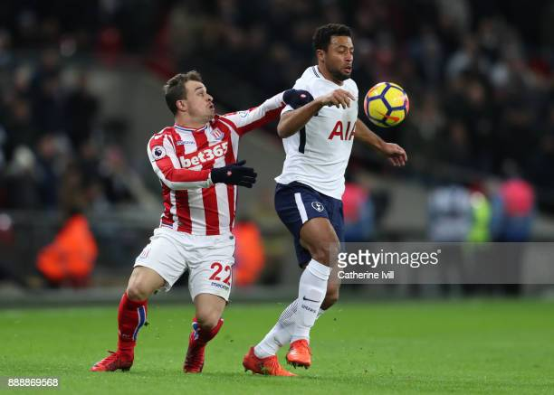 Xherdan Shaqiri of Stoke City contests for the ball with Mousa Dembele of Tottenham Hotspur during the Premier League match between Tottenham Hotspur...