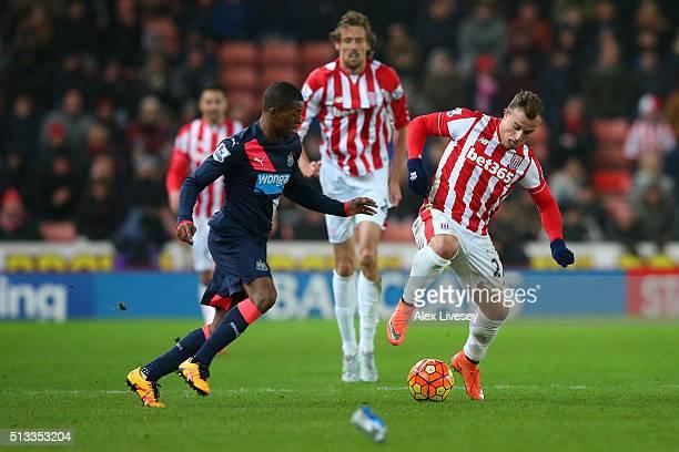 Xherdan Shaqiri of Stoke City evades Georginio Wijnaldum of Newcastle United during the Barclays Premier League match between Stoke City and...