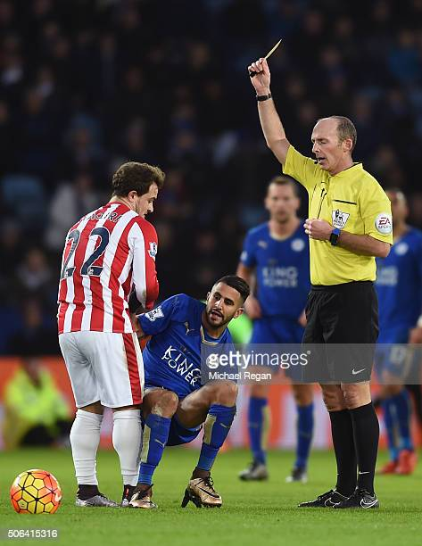 Xherdan Shaqiri of Stoke City is shown a yellow card by referee Mike Dean after fouling Riyad Mahrez of Leicester City during the Barclays Premier...