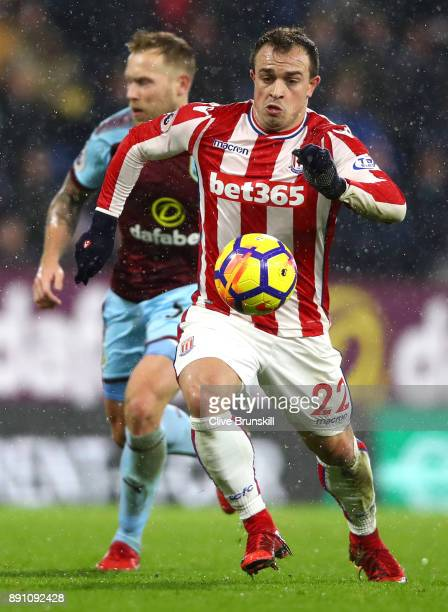 Xherdan Shaqiri of Stoke City runs with the ball during the Premier League match between Burnley and Stoke City at Turf Moor on December 12 2017 in...