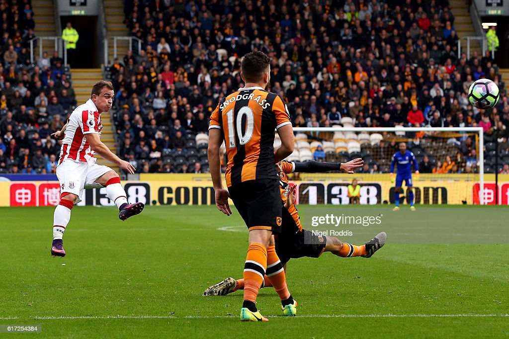 Xherdan Shaqiri of Stoke City (L) scores his sides first goal during the Premier League match between Hull City and Stoke City at the KCom Stadium on October 22, 2016 in Hull, England.