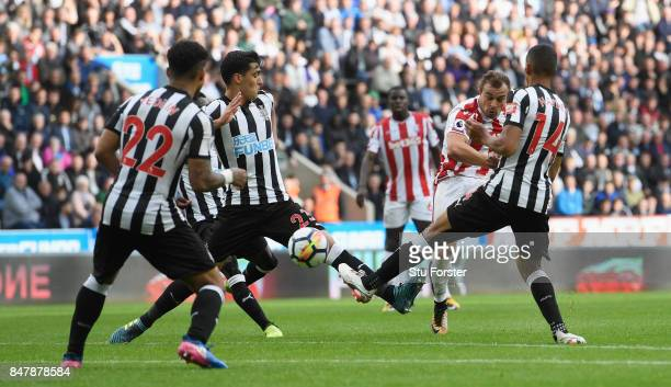Xherdan Shaqiri of Stoke City scores his sides first goal during the Premier League match between Newcastle United and Stoke City at St James Park on...
