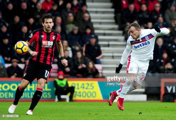 Xherdan Shaqiri of Stoke City scores his sides first goGordon Reid of Scotland during the Premier League match between AFC Bournemouth and Stoke City...