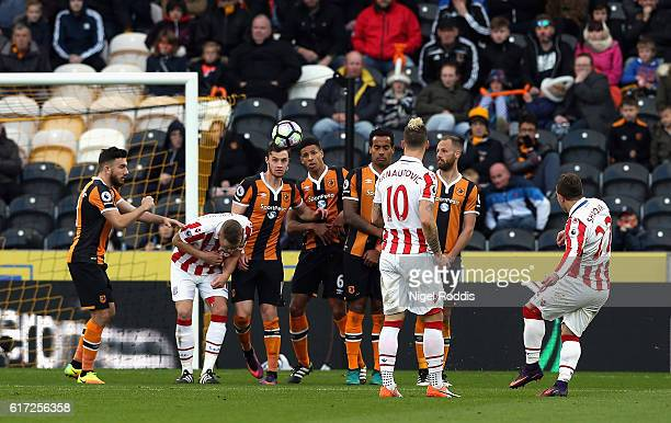 Xherdan Shaqiri of Stoke City scores his team's second goal from a free kick during the Premier League match between Hull City and Stoke City at the...