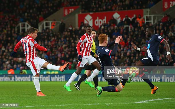 Xherdan Shaqiri of Stoke City scores the opening goal during the Barclays Premier League match between Stoke City and Newcastle United at the...