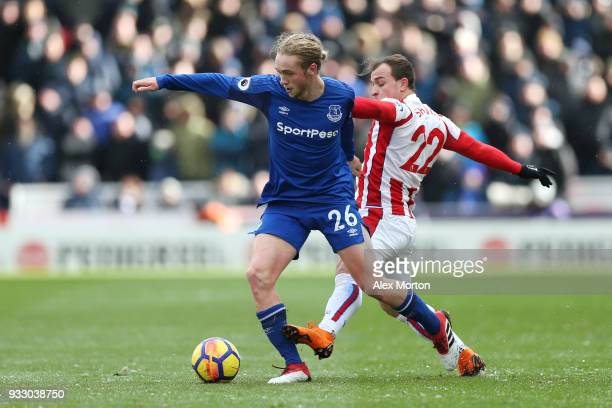 Xherdan Shaqiri of Stoke City tackles Tom Davies of Everton during the Premier League match between Stoke City and Everton at Bet365 Stadium on March...