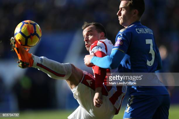 Xherdan Shaqiri of Stoke controls the ball under pressure from Ben Chilwell of Leicester during the Premier League match between Leicester City and...