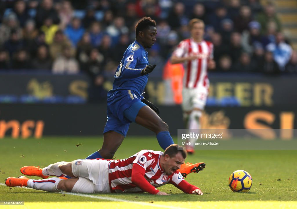 Xherdan Shaqiri of Stoke is left on the floor as Wilfred Ndidi takes the ball away during the Premier League match between Leicester City and Stoke City at The King Power Stadium on February 24, 2018 in Leicester, England.