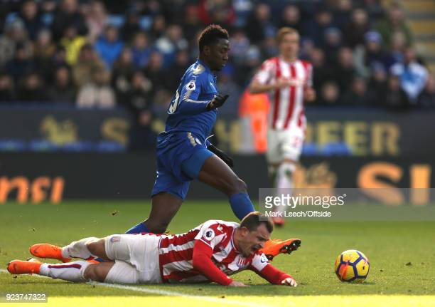 Xherdan Shaqiri of Stoke is left on the floor as Wilfred Ndidi takes the ball away during the Premier League match between Leicester City and Stoke...