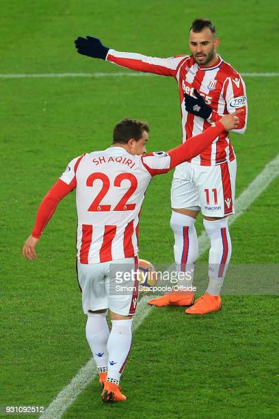 Xherdan Shaqiri of Stoke talks to teammate Jese of Stoke during the Premier League match between Stoke City and Manchester City at the Bet365 Stadium...