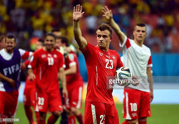 Xherdan Shaqiri of Switzerland acknowledges the fans after a 3-0 victory over Honduras in the 2014 FIFA World Cup Brazil Group E match between...