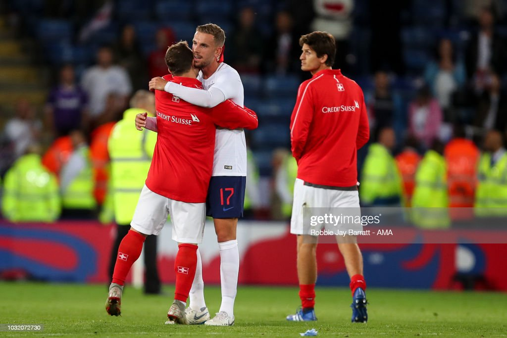 Xherdan Shaqiri of Switzerland and Jordan Henderson of England during the International Friendly match between England and Switzerland at The King Power Stadium on September 11, 2018 in Leicester, United Kingdom.