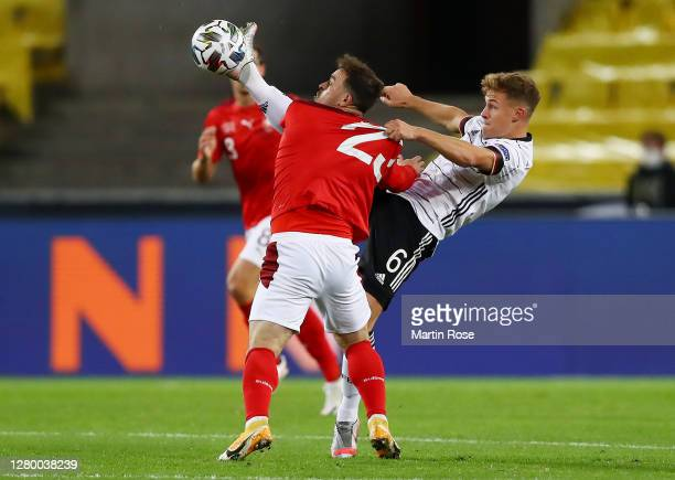Xherdan Shaqiri of Switzerland and Joshua Kimmich of Germany compete for the ball during the UEFA Nations League group stage match between Germany...