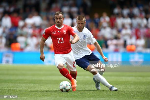 Xherdan Shaqiri of Switzerland battles for possession with Eric Dier of England during the UEFA Nations League Third Place Playoff match between...