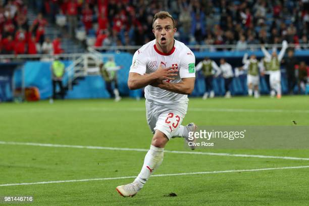 Xherdan Shaqiri of Switzerland celebrates after scoring his team's second goal during the 2018 FIFA World Cup Russia group E match between Serbia and...