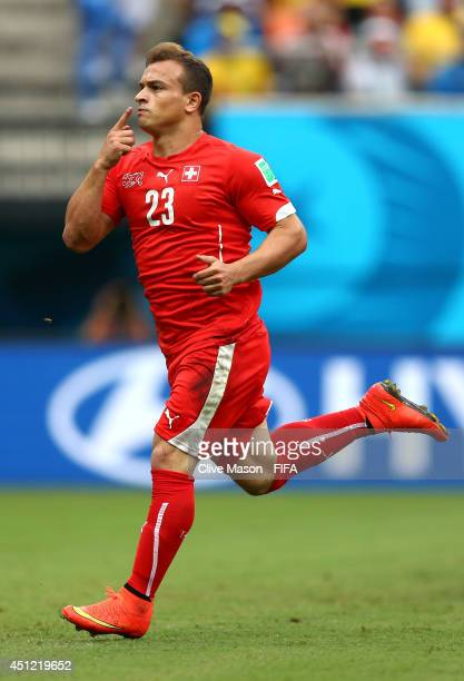 Xherdan Shaqiri of Switzerland celebrates scoring his team's first goal during the 2014 FIFA World Cup Brazil Group E match between Honduras and...