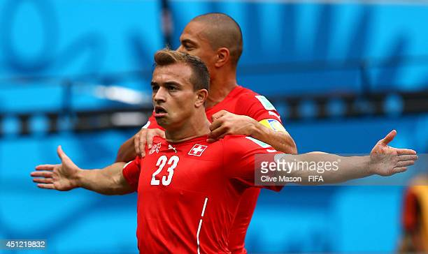 Xherdan Shaqiri of Switzerland celebrates scoring his team's first goal with his teammate Gokhan Inler of Switzerland during the 2014 FIFA World Cup...