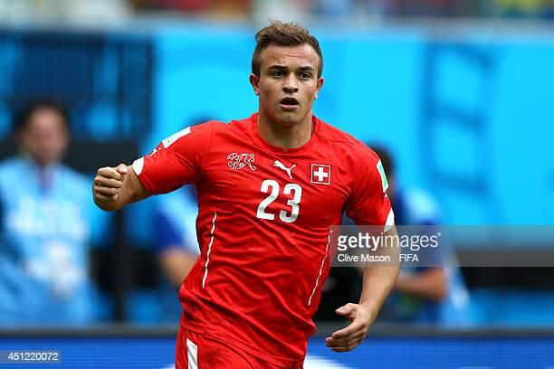 Xherdan Shaqiri of Switzerland celebrates scoring his team's first goal during the 2014 FIFA World Cup Brazil Group E match between Honduras and...