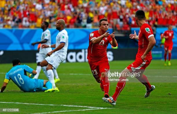 Xherdan Shaqiri of Switzerland celebrates scoring his team's second goal during the 2014 FIFA World Cup Brazil Group E match between Honduras and...