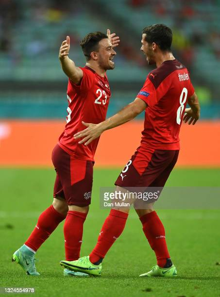 Xherdan Shaqiri of Switzerland celebrates with team mate Remo Freuler after scoring their team's second goal during the UEFA Euro 2020 Championship...