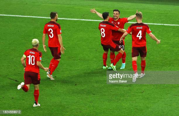 Xherdan Shaqiri of Switzerland celebrates with teammates after scoring their team's second goal during the UEFA Euro 2020 Championship Group A match...