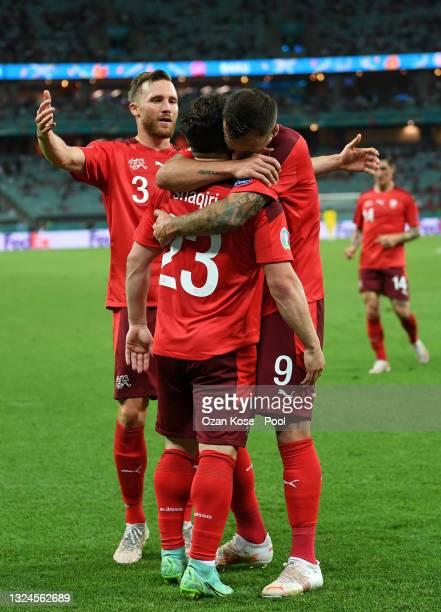 Xherdan Shaqiri of Switzerland celebrates with teammates after scoring their team's third goal during the UEFA Euro 2020 Championship Group A match...