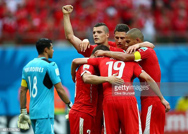 Xherdan Shaqiri of Switzerland celebrates with teammates scoring his team's third goal and completes his hat trick during the 2014 FIFA World Cup...