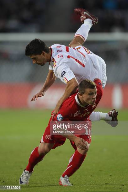 Xherdan Shaqiri of Switzerland feels the force of a challenge from Didac Vila of Spain during the UEFA European Under21 Championship Final match...