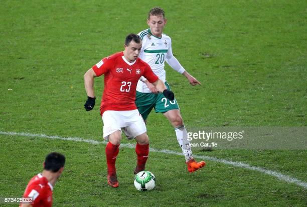 Xherdan Shaqiri of Switzerland George Saville of Northern Ireland during the FIFA 2018 World Cup Qualifier PlayOff Second Leg between Switzerland and...