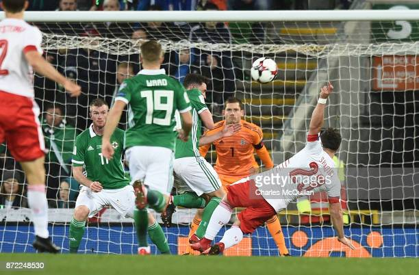 Xherdan Shaqiri of Switzerland is awarded a penalty after alleged handball by Corry Evans of Northern Ireland during the FIFA 2018 World Cup...
