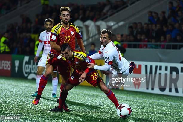 Xherdan Shaqiri of Switzerland is brought down by Jordi Rubio of Andorra during the FIFA 2018 World Cup Qualifier between Andorra and Switzerland at...