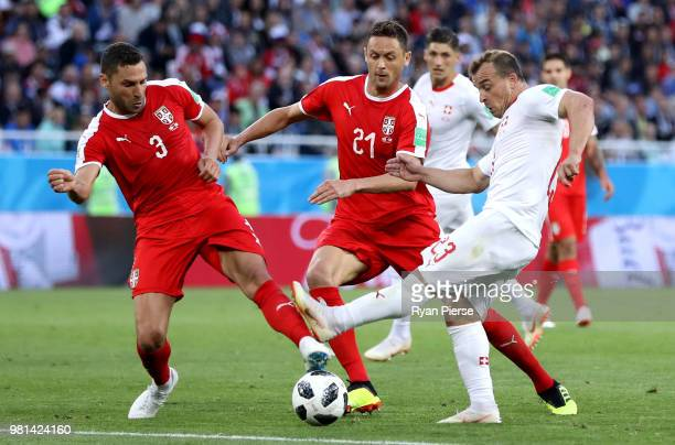 Xherdan Shaqiri of Switzerland is challenged by Dusko Tosic of Serbia and Nemanja Matic of Serbia during the 2018 FIFA World Cup Russia group E match...