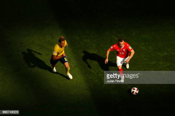 Xherdan Shaqiri of Switzerland is challenged by Ludwig Augustinsson of Sweden during the 2018 FIFA World Cup Russia Round of 16 match between Sweden...