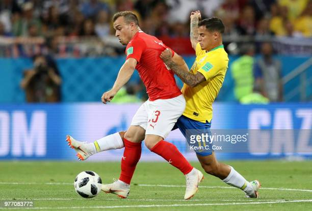 Xherdan Shaqiri of Switzerland is challenged by Philippe Coutinho of Brazil during the 2018 FIFA World Cup Russia group E match between Brazil and...