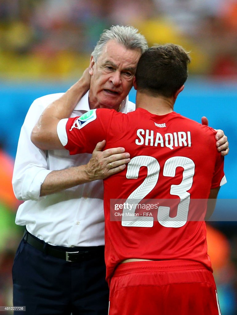 Xherdan Shaqiri (R) of Switzerland is congratulated by head coach Ottmar Hitzfeld as he is replaced during the 2014 FIFA World Cup Brazil Group E match between Honduras and Switzerland at Arena Amazonia on June 25, 2014 in Manaus, Brazil.