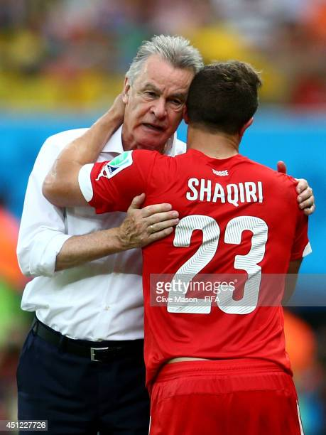 Xherdan Shaqiri of Switzerland is congratulated by head coach Ottmar Hitzfeld as he is replaced during the 2014 FIFA World Cup Brazil Group E match...
