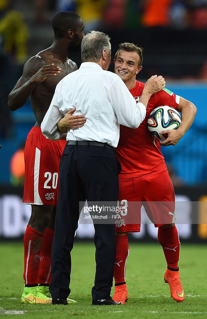 Xherdan Shaqiri of Switzerland is congratulated by head coach Ottmar Hitzfeld after his hat trick during the 2014 FIFA World Cup Brazil Group E match between Honduras and Switzerland at Arena Amazonia on June 25, 2014 in Manaus, Brazil.