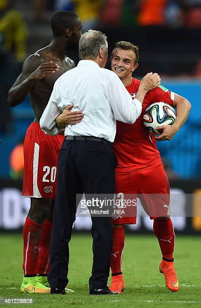 Xherdan Shaqiri of Switzerland is congratulated by head coach Ottmar Hitzfeld after his hat trick during the 2014 FIFA World Cup Brazil Group E match...