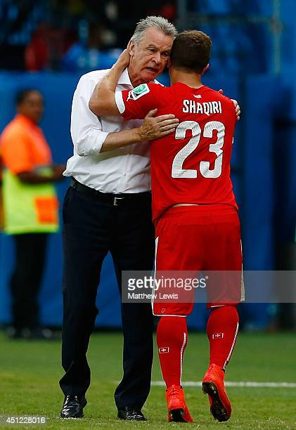 Xherdan Shaqiri of Switzerland is greeted by head coach Ottmar Hitzfeld after being substituted during the 2014 FIFA World Cup Brazil Group E match...