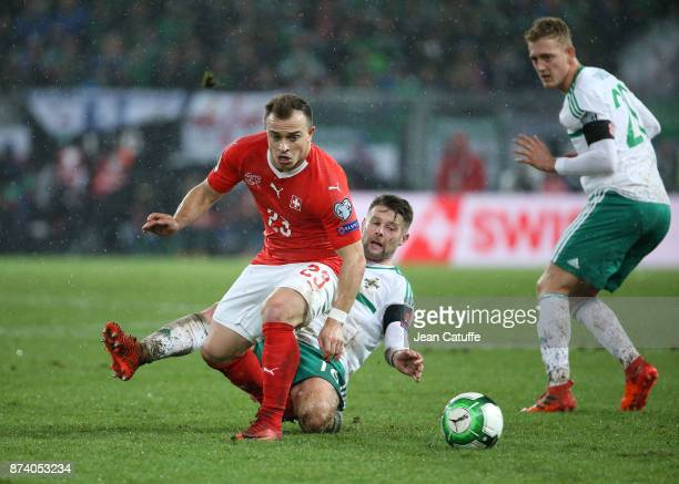 Xherdan Shaqiri of Switzerland Oliver Norwood of Northern Ireland during the FIFA 2018 World Cup Qualifier PlayOff Second Leg between Switzerland and...