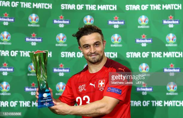 """Xherdan Shaqiri of Switzerland poses for a photograph with the Heineken """"Star of the Match"""" award following the UEFA Euro 2020 Championship Group A..."""