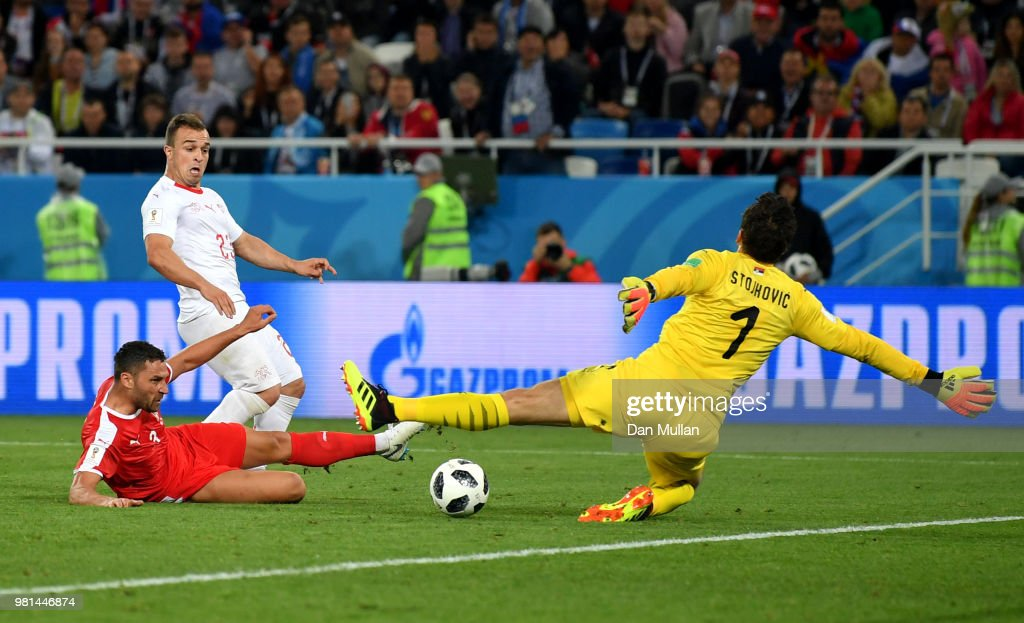 Xherdan Shaqiri of Switzerland scores his team's second goal pass Vladimir Stojkovic of Serbia during the 2018 FIFA World Cup Russia group E match between Serbia and Switzerland at Kaliningrad Stadium on June 22, 2018 in Kaliningrad, Russia.
