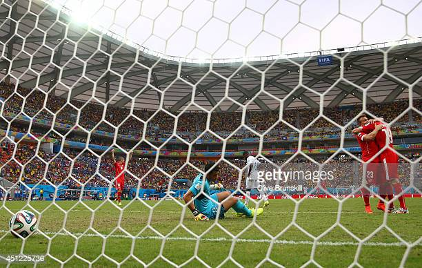 Xherdan Shaqiri of Switzerland shoots and scores his team's third goal and complete his hat trick during the 2014 FIFA World Cup Brazil Group E match...