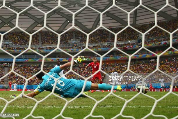 Xherdan Shaqiri of Switzerland shoots and scores his team's third goal past goalkeeper Noel Valladares of Honduras and completes his hat trick during...