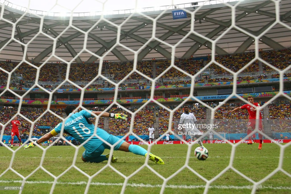 Xherdan Shaqiri of Switzerland shoots and scores his team's third goal and complete his hat trick during the 2014 FIFA World Cup Brazil Group E match between Honduras and Switzerland at Arena Amazonia on June 25, 2014 in Manaus, Brazil.